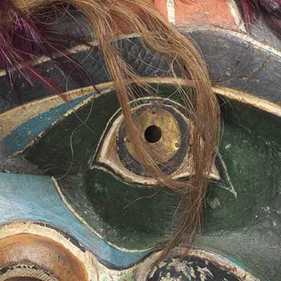 Close-up photograph showing detail of the eye of mask Bak'was with Snakes.