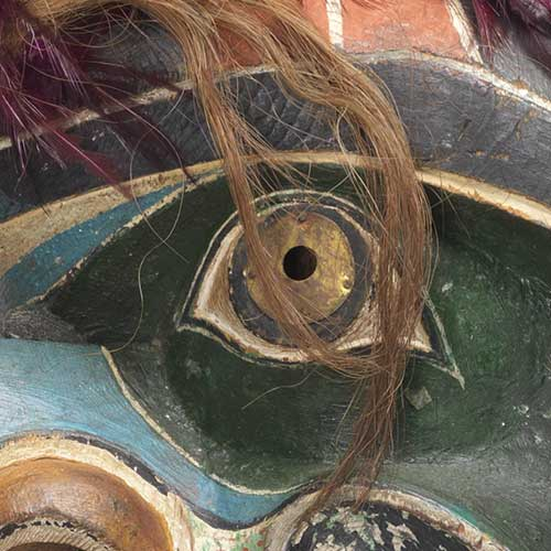 Colour photograph detail view of eye from Bakwas with Snakes mask