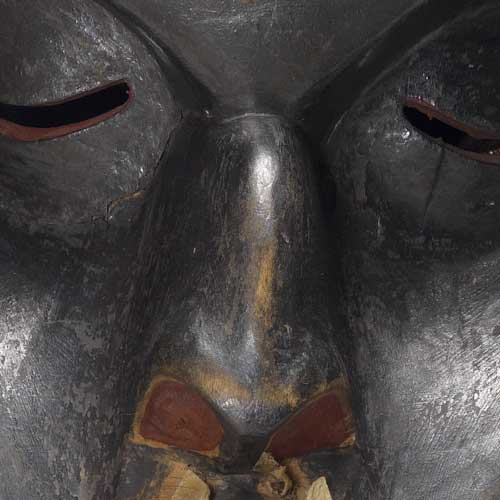 Colour photograph detail view showing bridge of nose from Dzunuḱwa Mask