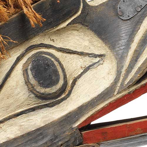 Colour photograph detail of eye from Gwaxgwakalanuksiwe' Raven-at-the-North-End-of-the-World Mask