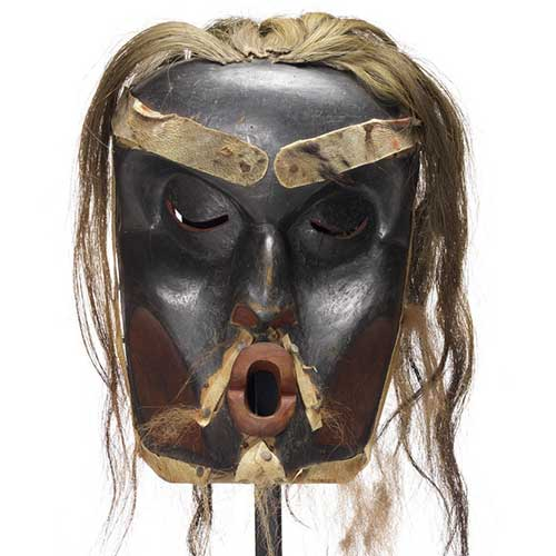 Chief's Dzunuk´wa mask and copper breaker, mask is deeply carved, dark with red patches, light hair trim.