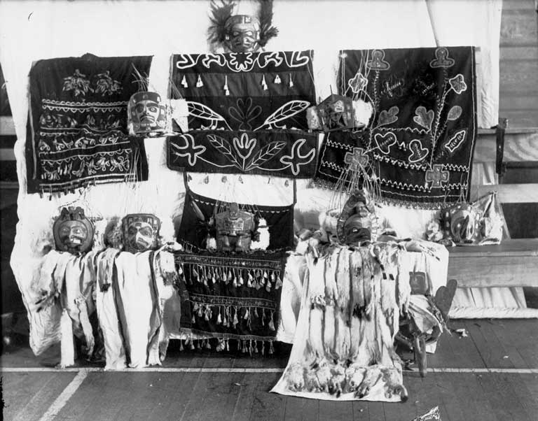 Four dance aprons are shown against a white backdrop, many of which are trimmed with ermine.