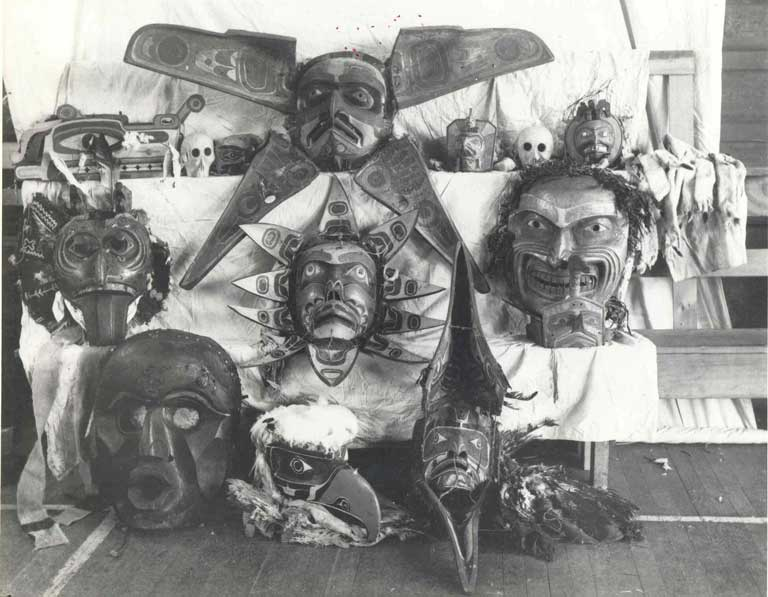 A group of confiscated masks is shown against a white backdrop, in the center are two large and impressive transformation masks.