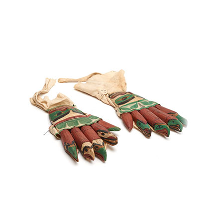 A pair of glove shaped rattles, each finger carved in animal shapes , part of a Bak´was or Wild Man of the Woods costume.