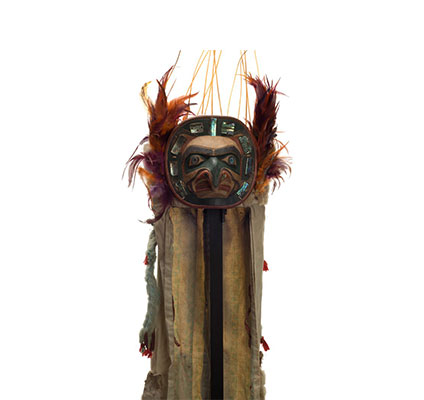 Yaxwiwe' or Hawk Headdress, abalone shell encircles hawk face on frontlet, feathers and sea lion whiskers above and at sides, long ermine and cotton train.