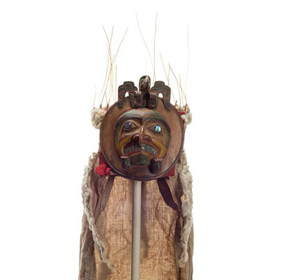 Yaxwiwe' or chief's headdress, round in shape, abalone teeth and eye, carved bird shape atop with cloth and ermine train.