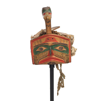 Łałkuxwiwe' or mallard headdress features a loon head and neck projecting above the hawk face frontlet, carved wooden feathers and wing.