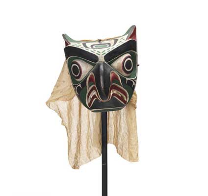 Daxdaxalułamł or Owl Mask, brightly coloured and patterned in black, red, green and white, cotton head covering.