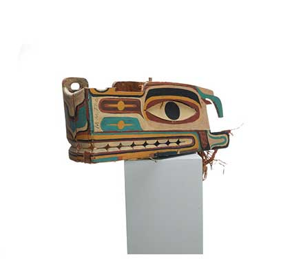 Haietlik or sea serpent mask, painted with geometric designs in a wide range of colours.