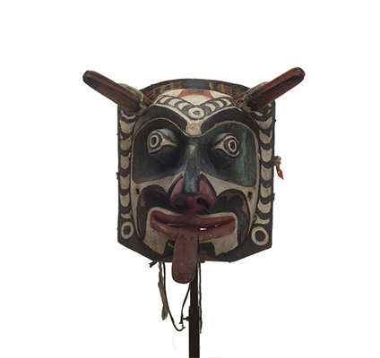 Xwixwi mask representing red snapper or cod angular corolla design decorated with black design elements incorporating circles and crescent shapes.