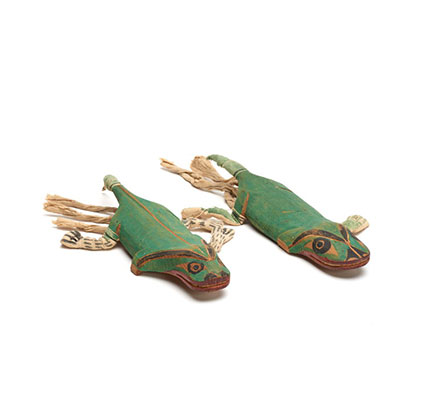Two carved salamander figures, attached to forearms with string, painted bright green, part of a Bak´was or Wild Man of the Woods costume.