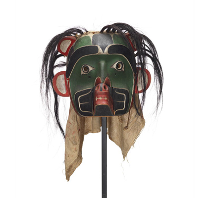 Sapagamł or echo mask, green and black with white red trim, interchangeable mouthpiece shown with bear.
