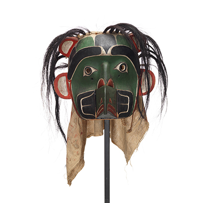 Sapagamł or echo mask, green and black with white red trim, interchangeable mouthpiece shown with wolf.
