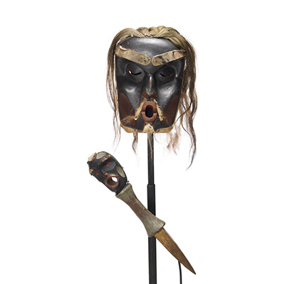 A Chief's Dzunuk´wa mask and copper breaker, mask is deeply carved, dark with red patches, light hair trim.