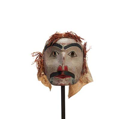 Atłakima or Forest Spirits Mask, white- washed cedar, rounded face shape with cedar bark hair and cotton back, dark prominent moustache and eyebrows.