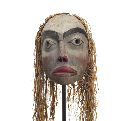 Forest spirit mask, feminine appearance, red lips and trim surrounding nostrils, rosy cheeks and long cedar bark trim.