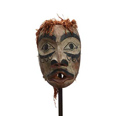 Wawaxanuwilana (Ground Preparer) mask, a type of Atłakima Forest Spirits Mask white washed with black markings on cheeks, pursed red lips with moustache.