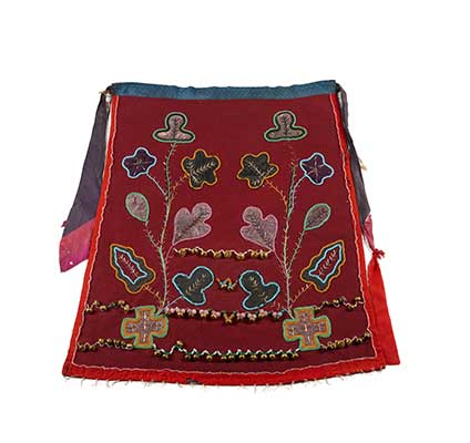 Dance apron with floral motif and two longer rows of bells at the bottom and a shorter row above those. The design is beaded and the main background colour of the apron is burgundy with a red border.