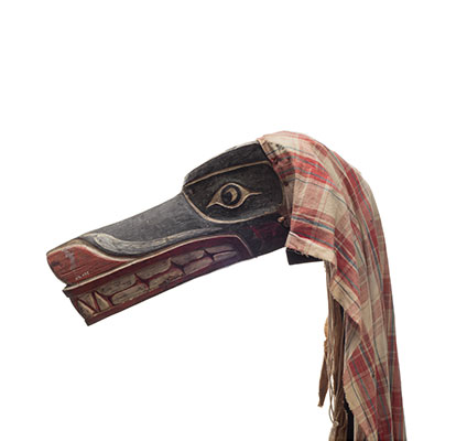 Xisiwe' or wolf mask, one of several with long snout and large teeth, painted red and black with plaid cotton head cover.