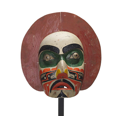 'Makwala or moon mask, red painted circular shape surrounds face which is painted white with green patches around eyes, black, orange yellow patterns.