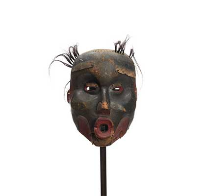 Dzunukwa or Wild Woman of the Woods, deeply carved, near black finish, large pursed lips and tufts of hair.