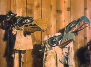 Image shows a group of 3 eagle masks installed in the Potlatch Gallery at U'mista Cultural Centre.